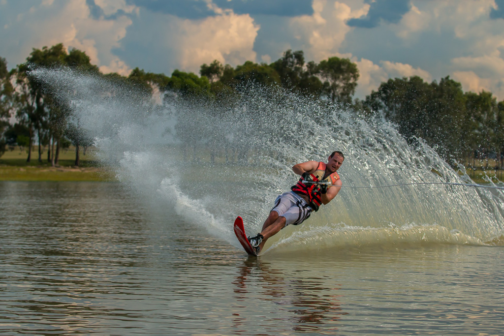 A water skier carving a wake